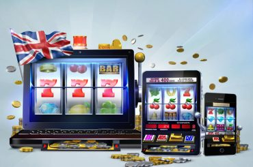 uk gambling - concept with laptop, tablet and mobile phone with the UK flag on top of it