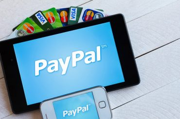 Paypal icon on a smartphone and tablet