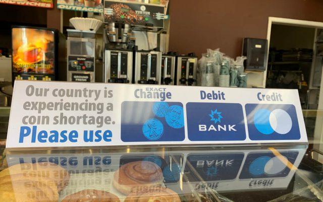 Coin shortage sign on shop counter